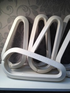 Porcelain lighting 'hooks' for a restaurant. Model, ,aster mould and fired pieces.