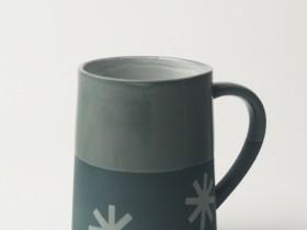 Graphic 12 oz Taper Mug: 'Starburst'. Dark blue/clear glaze top.
