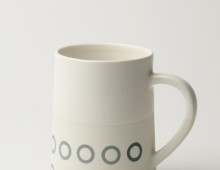 Graphic Taper 12 oz Mug: 'Circles'. White/ white glaze top.